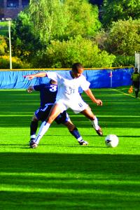Tyler Stauffer photo: Sophomore Austin Solomon fights for ball against a defender.